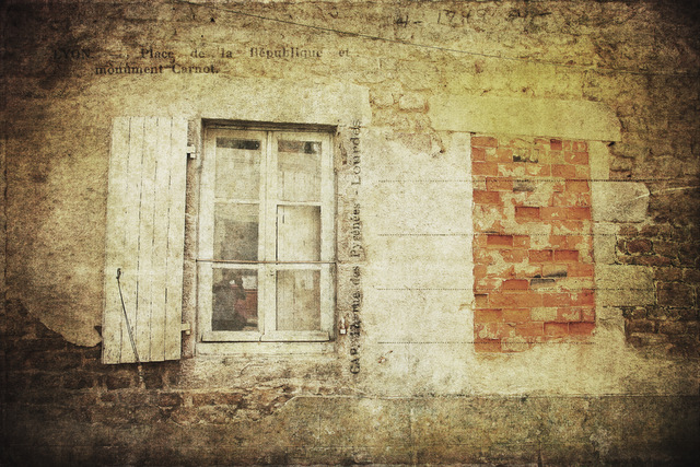 An old French window and a bricked up window
